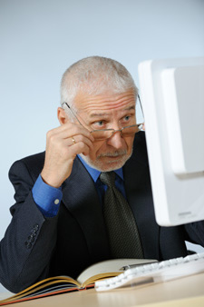 Mature Businessman staring at computer_1.jpg